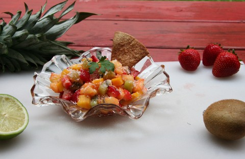 A salsa of mangoes, pineapples, kiwi, strawberries, lime juice, and shredded coconut.